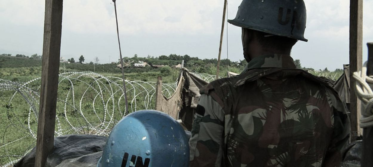 Two United Nations Peacekeepers shown from behind